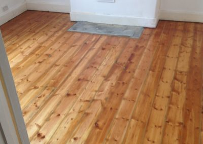 Lacquer floorboards second coat